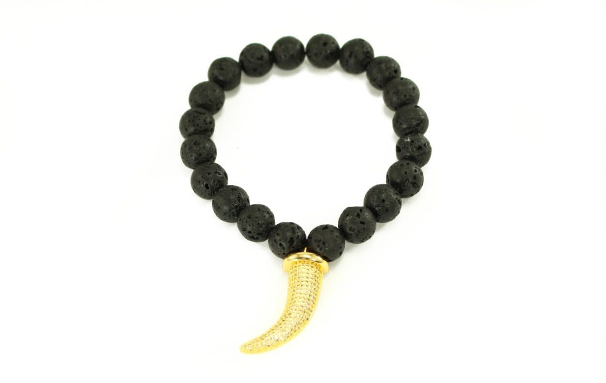 Crystal Dreams Lava Stone Golden Tiger Tooth Charm Bracelet in Gold